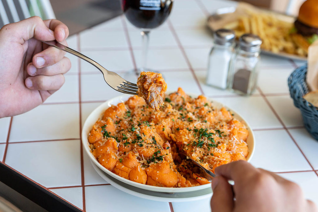 Man eats gnocchi from launch menu at ambarvale