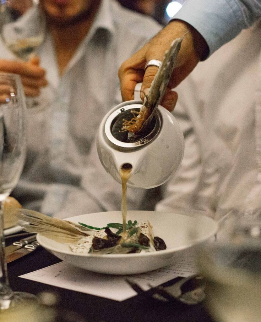 Launches and Events Someone pouring a fish broth from a teapot onto a Barramundi Dinner for their B2B Campaign Event