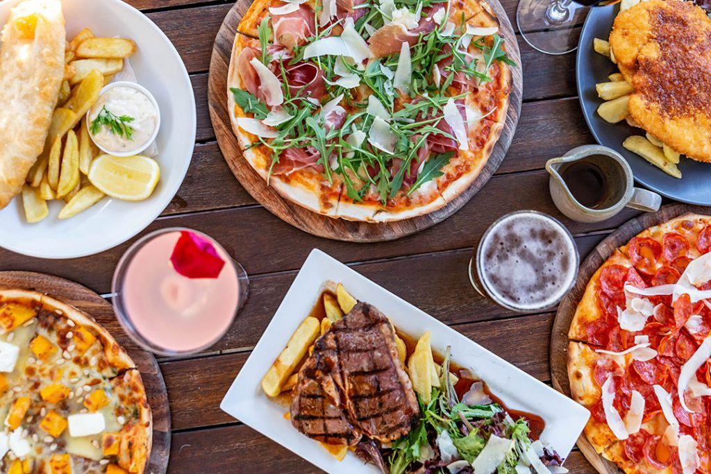 Still from video Pizza, steaks and pub food on a flat-lay at Sydneys Helm Bar