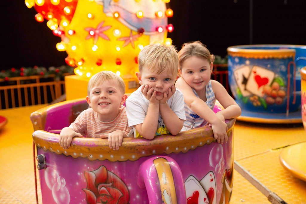 Event PR photography for Christmas wonderland children in teacup ride