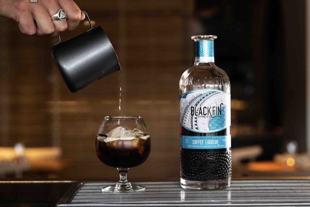 Brand Launch for Blackfin, a shot of coffee being poured into brand glass with the spirit