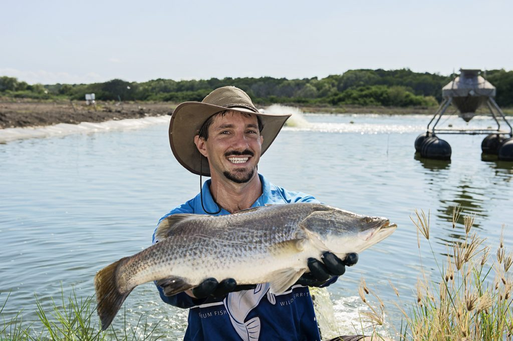 Farmer holding Barramundi for B2B Campaign
