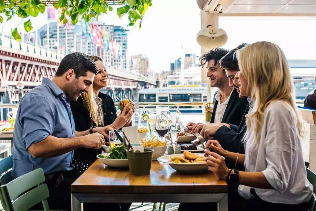 Public Relations collateral Group of people enjoying a pub meal at Helm Bar in Sydney by Darling Harbour