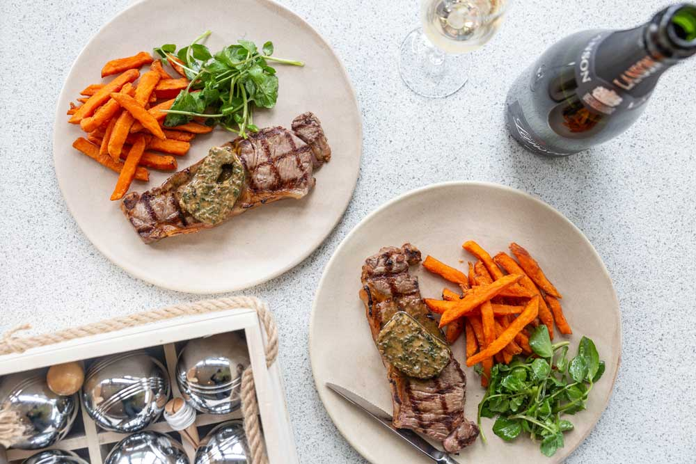 Event Pr Campaign photography for Fernery focusing on the steak frites in bar with petanque ball in background