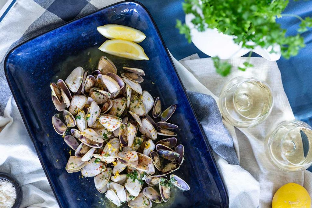 Recipe Photoshoot flatlay of pipis in blue dish